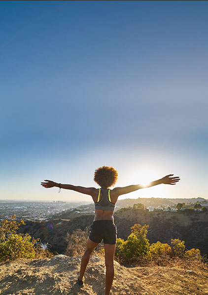 Woman open her arms in the Runyon Canyon